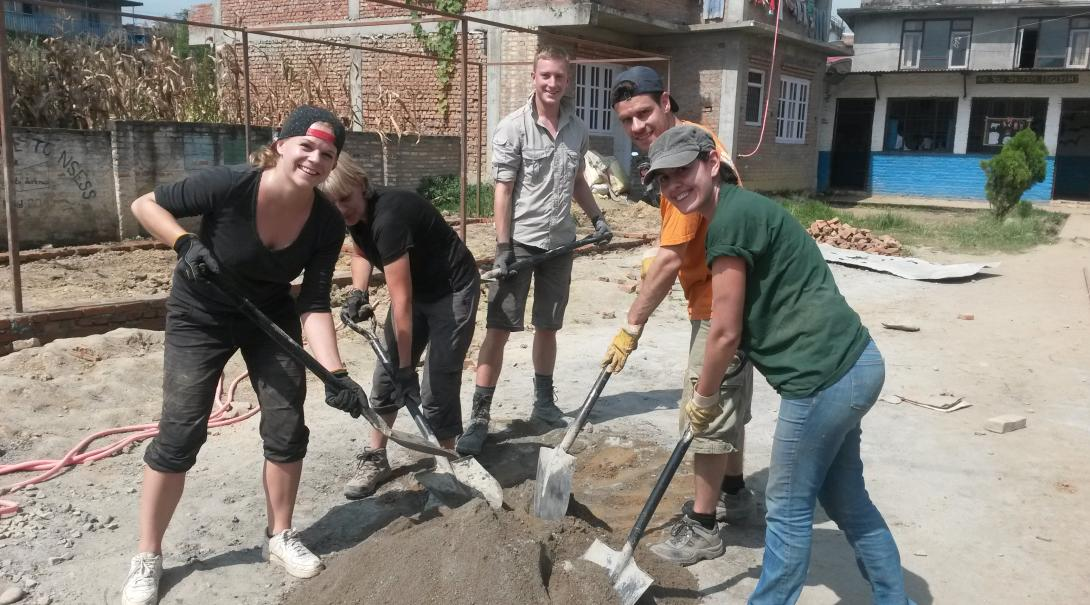 A group of volunteers dig foundations for a school at the 2015 Disaster Relief placement in Nepal
